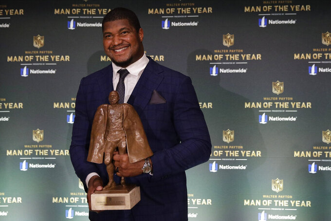 Jacksonville Jaguars' Calais Campbell poses after winning the Walter Payton NFL Man of the Year trophy at the NFL Honors football award show Saturday, Feb. 1, 2020, in Miami. (AP Photo/Patrick Semansky)