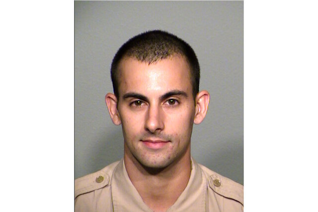 A photo provided by the Las Vegas Metropolitan Police Department shows officer Shay Kellin Mikalonis. Edgar Samaniego, accused of shooting and critically wounding Mikalonis, is to remain jailed pending arraignment Friday, June 5, 2020, on attempted murder and weapon charges, the man's public defense lawyer said. Mikalonis, 29, underwent surgery for spine and head injuries after being hit in the back of the neck June 1 by a gunshot that officials say was fired from across Las Vegas Boulevard during a nighttime protest over the May 25 death of a black man in police custody in Minneapolis. (Las Vegas Metropolitan Police Department via AP)