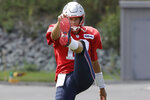 New England Patriots quarterback Tom Brady warms up during an NFL football practice, Wednesday, Sept. 4, 2019, in Foxborough, Mass. (AP Photo/Steven Senne)