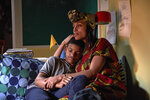 """This image released by RLJE films shows Lonnie Chavis, left, and Rosario Dawson in a scene from """"The Water Man,"""" a film by David Oyelowo. (Karen Ballard/RLJE films via AP)"""