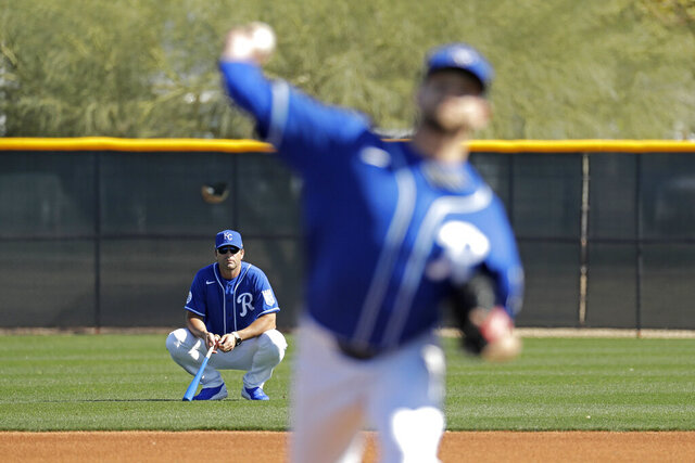 FILE - In this Feb. 16, 2020, file photo, Kansas City Royals manager Mike Matheny, back left, watches as pitcher Jesse Hahn throws during spring training baseball practice in Surprise, Ariz. The Royals had an entire offseason and most of spring training to get to know Mike Matheny. But one unintended consequence of the coronavirus pandemic is they've gotten to know their new manager better than they could ever have imagined. (AP Photo/Charlie Riedel, File)