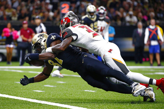 New Orleans Saints tight end Jared Cook scores a touchdown against Tampa Bay Buccaneers free safety Jordan Whitehead in the first half of an NFL football game in New Orleans, Sunday, Oct. 6, 2019. (AP Photo/Butch Dill)