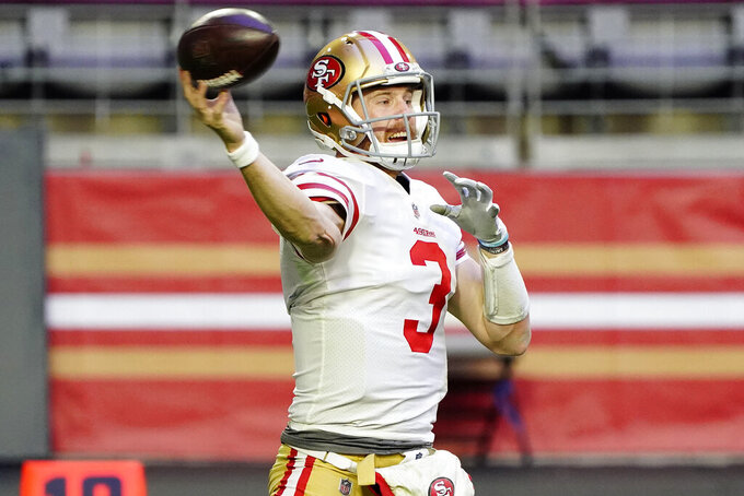 San Francisco 49ers quarterback C.J. Beathard (3) throws against the Seattle Seahawks during the first half of an NFL football game, Sunday, Jan. 3, 2021, in Glendale, Ariz. (AP Photo/Rick Scuteri)