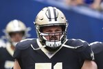 FILE - New Orleans Saints tackle Ryan Ramczyk (71) is shown on the field before the start of an NFL football game against the Los Angeles Rams in Los Angeles, in this Sunday, Sept. 15, 2019, file photo. Saints right tackle Ryan Ramczyk has agreed to a five-year extension worth up to $96 million, a person with knowledge of the situation said. The person spoke to The Associated Press on Wednesday, June 30, 2021, because the new contract for the 2019 All-Pro offensive lineman has not been announced.  (AP Photo/John Cordes, File)