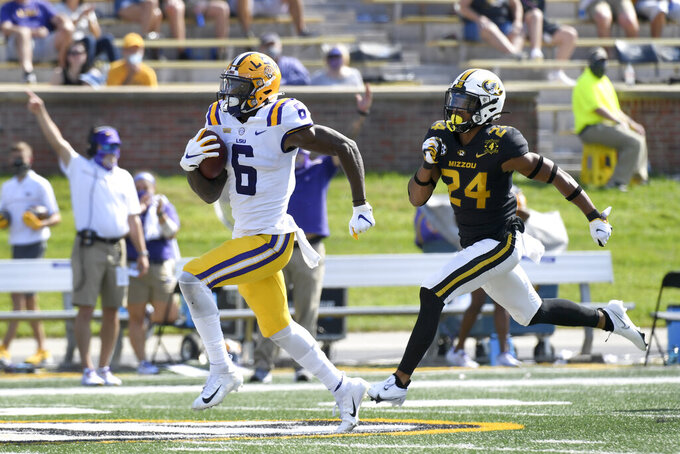 LSU wide receiver Terrace Marshall Jr. (6) scores past Missouri defensive back Ishmael Burdine during the second half of an NCAA college football game Saturday, Oct. 10, 2020, in Columbia, Mo. (AP Photo/L.G. Patterson)
