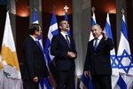 Greece's Prime Minister Kyriakos Mitsotakis, center, Cypriot President Nicos Anastasiadis, left, and Israeli Prime Minister Benjamin Netanyahu pose for a photograph ahead of a signing ceremony in Athens, Thursday, Jan. 2, 2020.  The leaders of Greece, Israel and Cyprus met in Athens Thursday to sign a deal aiming to build a key undersea pipeline, named EastMed, designed to carry gas from new rich offshore deposits in the southeastern Mediterranean to continental Europe. (AP Photo)