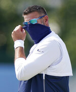 FILE - In this Aug. 18, 2020, file photo, Tennessee Titans head coach Mike Vrabel adjusts his mask during NFL football training camp in Nashville, Tenn. On Sunday, Oct. 25, Steelers-Titans will be the eighth time in league history undefeated and untied teams with at least five wins have met in the regular season, the sixth such game since the 1970 merger, and only the fifth in the past 46 seasons. (AP Photo/Mark Humphrey, Pool, File)