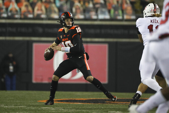 Oregon State quarterback Chance Nolan (10) looks for a receiver during the first half of the team's NCAA college football game against Stanford in Corvallis, Ore., Saturday, Dec. 12, 2020. (AP Photo/Amanda Loman)