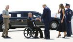 President Donald Trump and Melania Trump greet Texas Gov. Greg Abbott after arriving in El Paso, Texas, Wednesday, Aug. 7, 2019, to meet with law enforcement and victims of Saturday's mass shooting. U.S. Sen. John Cornyn is at left. (Mark Lambie/The El Paso Times via AP)