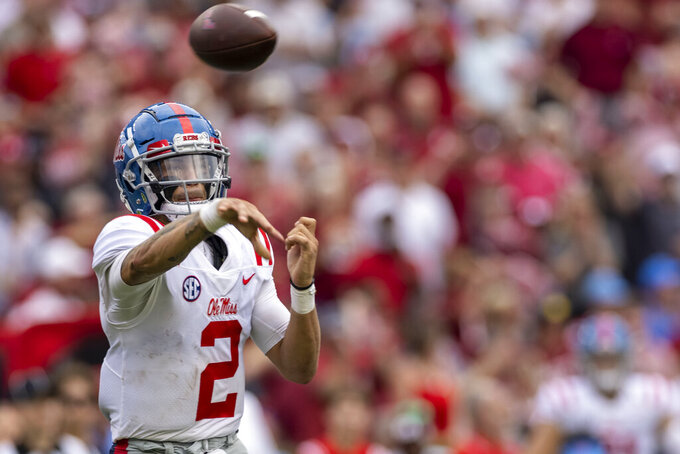 Mississippi quarterback Matt Corral (2) throws to the side against Alabama during the second half of an NCAA college football game, Saturday, Oct. 2, 2021, in Tuscaloosa, Ala. (AP Photo/Vasha Hunt)