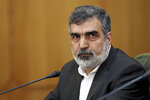 FILE - In this July 7, 2019, file photo, spokesman of the Atomic Energy Organization of Iran Behrouz Kamalvandi attends a press briefing in Tehran, Iran. Iran has begun injecting uranium gas into advanced centrifuges in violation of its 2015 nuclear deal with world powers, Kamalvandi said Saturday, Sept. 7, 2019. (AP Photo/Ebrahim Noroozi, File)