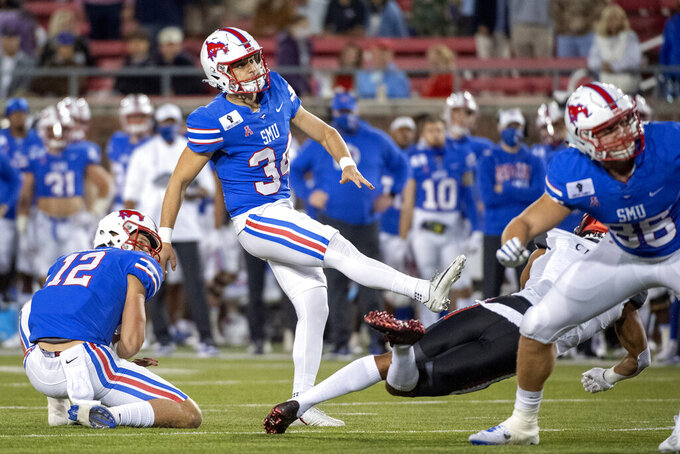 SMU kicker Chris Naggar (34) and holder Derek Green (12) watch the flight of Naggar's field goal against Cincinnati at the end of the first half of an NCAA college football game Saturday, Oct. 24, 2020, in Dallas. (AP Photo/Jeffrey McWhorter)