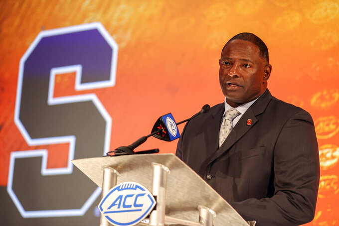 Syracuse head coach Dino Babers answers a question during an NCAA college football news conference at the Atlantic Coast Conference media days in Charlotte, N.C., Thursday, July 22, 2021. (AP Photo/Nell Redmond)
