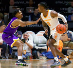Tennessee guard Jordan Bone (0) looks to pass as Tennessee Tech guard J.R. Clay (4) defends in the first half of an NCAA college basketball game Saturday, Dec. 29, 2018, in Knoxville, Tenn. (AP Photo/Shawn Millsaps)