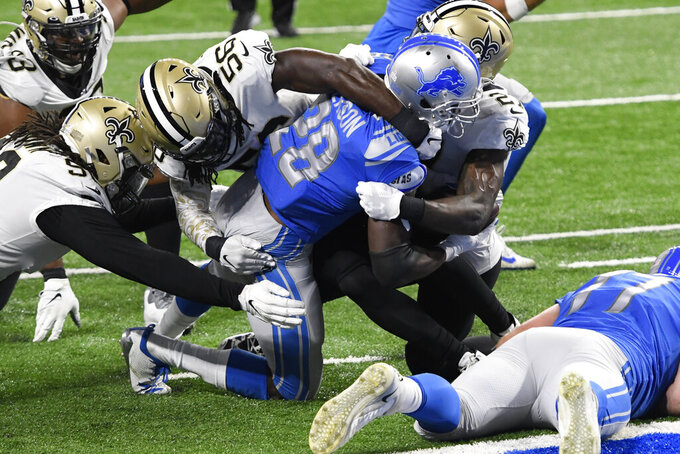 Detroit Lions running back Adrian Peterson (28) is stopped short of the goal line by the New Orleans Saints defense during the second half of an NFL football game, Sunday, Oct. 4, 2020, in Detroit. (AP Photo/Jose Juarez)