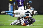 Baltimore Ravens tight end Josh Oliver is tackled by Carolina Panthers linebacker Frankie Luvu during the first half of a preseason NFL football game Saturday, Aug. 21, 2021, in Charlotte, N.C. (AP Photo/Jacob Kupferman)