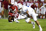 Arkansas running back Devwah Whaley, left, is tackled by San Jose State defender Kyle Harmon during the first half of an NCAA college football game, Saturday, Sept. 21, 2019, in Fayetteville, Ark. (AP Photo/Michael Woods)