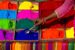 In this Wednesday, Nov. 7, 2018, file photo, a Nepalese vendor sells powder during Tihar festival in Kathmandu, Nepal. Hindus decorate their houses and worship, Lakshmi, the goddess of wealth during the Tihar festival. (AP Photo/Niranjan Shrestha, File)