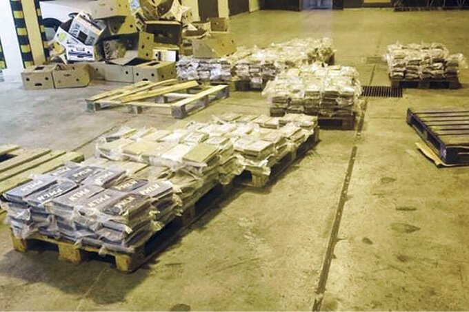 Packets containing cocaine which was hidden in boxes of bananas are seen at Malta Freeport, an international transshipment hub on Malta's southeastern tip, after it was seized by Customs Malta, late Tuesday, June 8, 2021. The customs department in Malta intercepted 740 kilograms (1,630 pounds) of cocaine Tuesday in a record-breaking drug seizure for the Mediterranean island nation, officials said. (Customs Malta via AP)