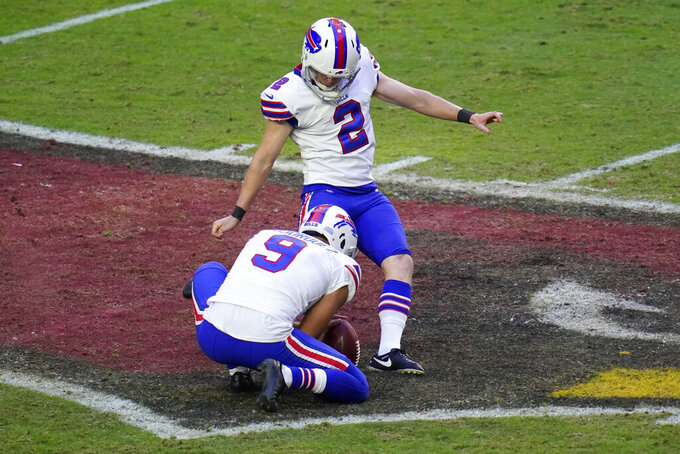 Buffalo Bills kicker Tyler Bass (2) kicks a field goal as punter Corey Bojorquez (9) holds during the first half of an NFL football game against the Arizona Cardinals, Sunday, Nov. 15, 2020, in Glendale, Ariz. (AP Photo/Ross D. Franklin)