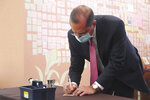 U.S. Health and Human Services Secretary Alex Azar writes a note at a memorial for former Taiwanese President Lee Teng-hui in Taipei, Taiwan, Wednesday, Aug. 12, 2020. Wednesday is the last day of Azar's schedule during the highest-level visit by an American Cabinet official since the break in formal diplomatic ties between Washington and Taipei in 1979. (Wang Teng-yi/Pool Photo via AP)