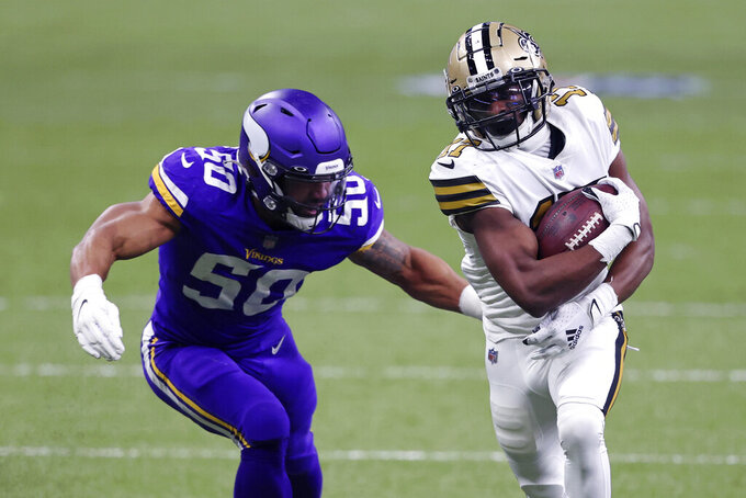 New Orleans Saints wide receiver Emmanuel Sanders (17) carries on a reception against Minnesota Vikings outside linebacker Eric Wilson (50) in the first half of an NFL football game in New Orleans, Friday, Dec. 25, 2020. (AP Photo/Butch Dill)