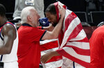 United States' Kevin Durant (7), right, celebrates with head coach Gregg Popovich after their win in the men's basketball gold medal game against France at the 2020 Summer Olympics, Saturday, Aug. 7, 2021, in Saitama, Japan. (AP Photo/Luca Bruno)
