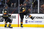 Vegas Golden Knights left wing Tomas Nosek (92) celebrates next to William Carrier after scoring against the Toronto Maple Leafs during the third period of an NHL hockey game Tuesday, Nov. 19, 2019, in Las Vegas. (AP Photo/John Locher)
