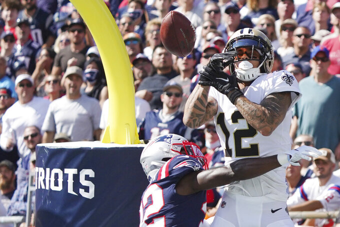 New England Patriots free safety Devin McCourty, bottom, breaks up a pass to New Orleans Saints wide receiver Kenny Stills (12) during the first half of an NFL football game, Sunday, Sept. 26, 2021, in Foxborough, Mass. (AP Photo/Mary Schwalm)