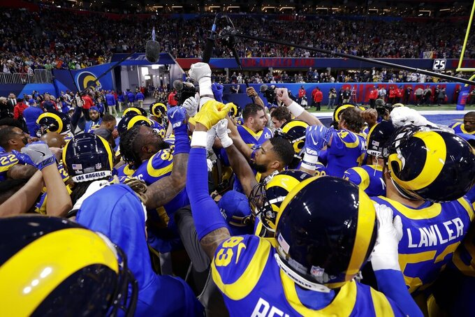 Los Angeles Rams players huddle together before the NFL Super Bowl 53 football game between the Rams and the New England Patriots Sunday, Feb. 3, 2019, in Atlanta. (AP Photo/David J. Phillip)