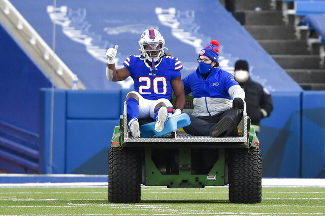Buffalo Bills running back Zack Moss (20) is carted off the field during the second half of an NFL wild-card playoff football game against the Indianapolis Colts, Saturday, Jan. 9, 2021, in Orchard Park, N.Y. (AP Photo/Adrian Kraus)