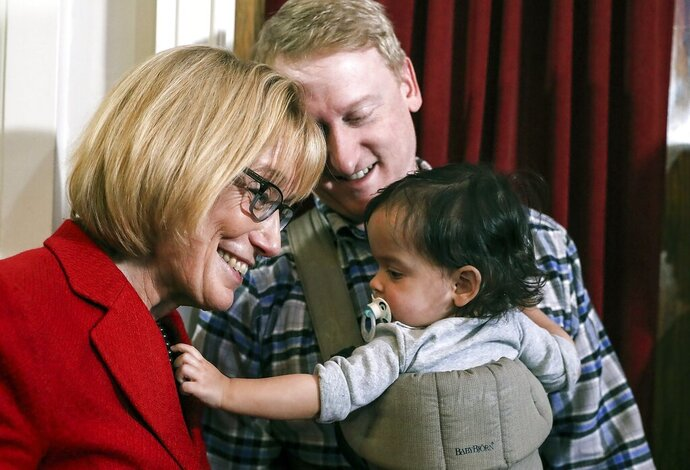 FILE - In this Dec. 8, 2018 file photo, U.S. Sen. Maggie Hassan stands with state Senate Majority Leader Dan Feltes, center, of Concord, and his daughter, Iris, at a post-midterm election victory celebration in Manchester, N.H. Feltes announced in an online video on Tuesday, Sept. 3, 2019, that he is seeking the Democratic nomination for New Hampshire governor. (AP Photo/Cheryl Senter, File)