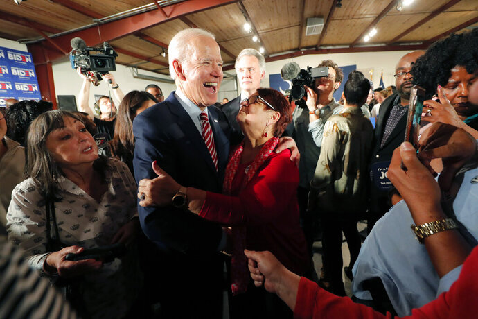 Democratic presidential candidate, former Vice President Joe Biden, greets supporters at a campaign event in Columbia, S.C., Tuesday, Feb. 11, 2020. (AP Photo/Gerald Herbert)