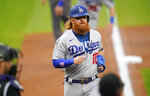 Los Angeles Dodgers' Justin Turner nears home to score on a triple by Chris Taylor off Colorado Rockies starting pitcher Chi Chi Gonzalez during the first inning of a baseball game Saturday, Sept. 19, 2020, in Denver. (AP Photo/David Zalubowski)