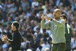 Manchester City's head coach Pep Guardiola gestures during the English Premier League soccer match between Manchester City and Arsenal at Etihad stadium in Manchester, England, Saturday, Aug. 28, 2021. (AP Photo/Rui Vieira)