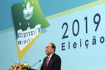 In this photo released by the Macao Government Office, newly elected Macao Chief Executive Ho lat-seng speaks after the election in Macao, Sunday, Aug. 25, 2019. An elite pro-Beijing panel has chosen a new leader for the Chinese casino gambling hub Macao. Ho was picked Sunday to be the next chief executive of the former Portuguese colony in a selection process with no other candidates. (Macao Government Office via AP)