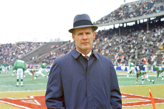 "FILE - This is a Dec. 1967 file photo showing Dallas Cowboys football coach Tom Landry. Landry built that franchise from the ground up to challenge the Packers for NFL dominance at the end of the 1960s and later become known as ""America's Team."" (AP Photo/File)"