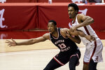Western Kentucky center Charles Bassey (23) and Alabama guard Joshua Primo (11) battle under the basket during the first half of an NCAA college basketball game, Saturday, Dec. 19, 2020, in Tuscaloosa, Ala. (AP Photo/Vasha Hunt)