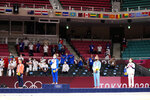 From left, silver medalist Funa Tonaki of Japan, gold medalist Distria Krasniqi of Kosovo, and bronze medalists Daria Bilodid of Ukraine and Urantsetseg Munkhbat of Mongolia stand during the medal ceremony for women's -48kg judo at the 2020 Summer Olympics, Saturday, July 24, 2021, in Tokyo, Japan. (AP Photo/Vincent Thian)