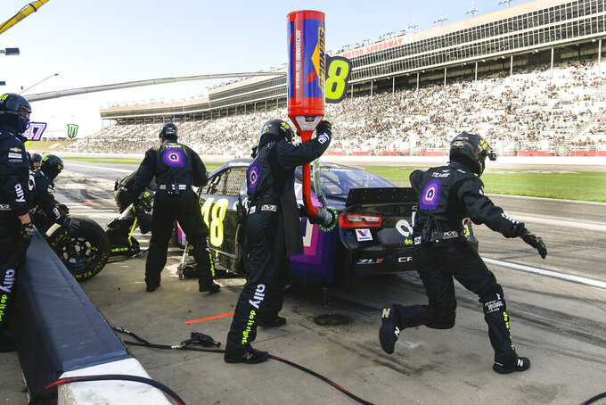Jimmie Johnson makes a pit stop during a NASCAR Monster Energy NASCAR Cup Series auto race at Atlanta Motor Speedway, Sunday, Feb. 24, 2019, in Hampton, Ga. (AP Photo/John Amis)