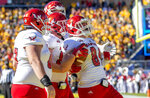Eastern Washington tight end Jayce Gilder (89) is congratulated by offensive lineman D.J. Dyer, left; tight end Henderson Belk, middle; and wide receiver Champ Grayson, rear, after scoring on a fake field goal during the first half of the FCS championship NCAA college football game against North Dakota State, Saturday, Jan. 5, 2019, in Frisco, Texas. (AP Photo/Jeffrey McWhorter)