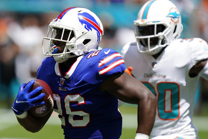 Buffalo Bills running back Devin Singletary (26) runs to score a touchdown during the first half of an NFL football game, Sunday, Sept. 19, 2021, in Miami Gardens, Fla. (AP Photo/Wilfredo Lee)