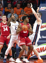 Wisconsin guard Khalil Iverson (21) is defended by Illinois forwards Kipper Nichols (2) and iorgi Bezhanishvili during the first half of an NCAA college basketball game in Champaign, Ill., Wednesday, Jan. 23, 2019. (AP Photo/Stephen Haas)