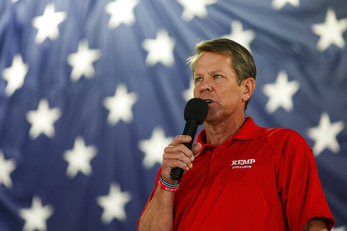 FILE - Georgia Gov. Brian Kemp speaks during the 17th annual Floyd County GOP Rally at the Coosa Valley Fairgrounds on Saturday, Aug. 7, 2021 in Rome, Ga. Kemp issued an executive order Thursday, Aug. 19 that bans cities from requiring businesses to enforce local restrictions aimed at curbing the coronavirus pandemic, but what impact, if any, the measure would have on new mask requirements in Atlanta, Savannah and other cities was not clear. (Troy Stolt/Chattanooga Times Free Press via AP, File)
