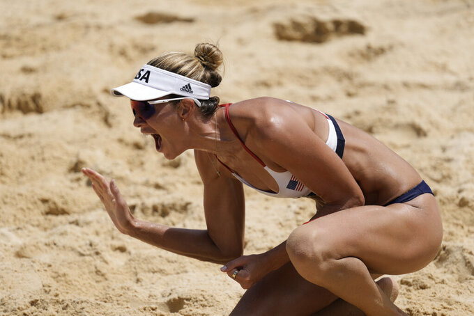 Alix Klineman, of the United States, celebrates winning a women's beach volleyball Gold Medal match against Australia at the 2020 Summer Olympics, Friday, Aug. 6, 2021, in Tokyo, Japan. (AP Photo/Petros Giannakouris)