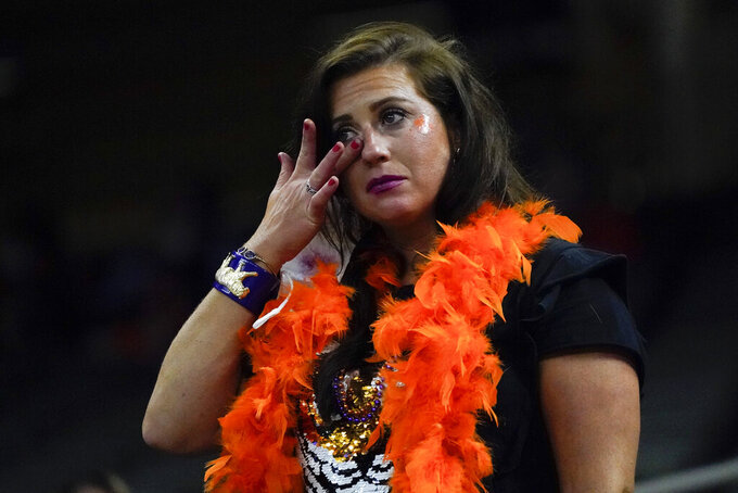 A Clemson fan wipes away a tear during the second half of the Sugar Bowl NCAA college football game against Ohio State Friday, Jan. 1, 2021, in New Orleans. (AP Photo/Gerald Herbert)