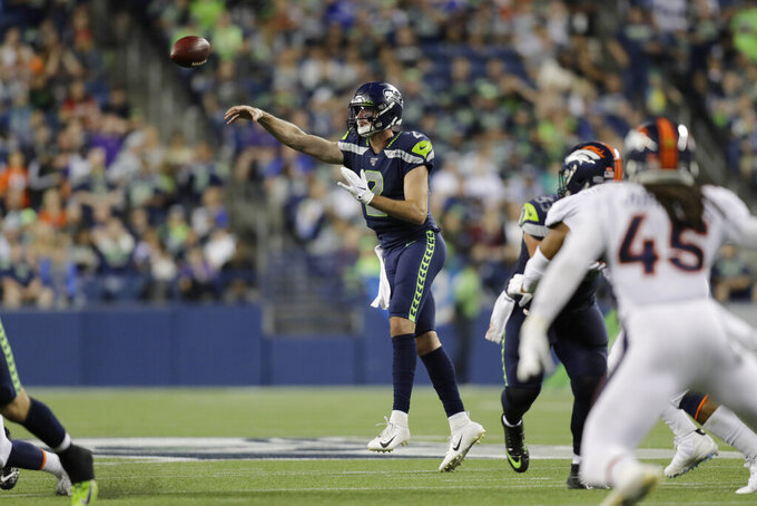 Seattle Seahawks quarterback Paxton Lynch throws a pass against the Denver Broncos during the second half of an NFL football preseason game Thursday, Aug. 8, 2019, in Seattle. (AP Photo/Stephen Brashear)