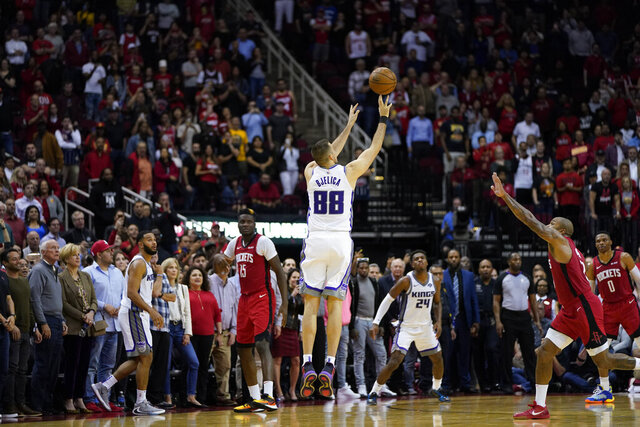 Sacramento Kings' Nemanja Bjelica (88) hits the game-winning 3-point-basket at the buzzer in the second half of an NBA basketball game against the Houston Rockets Monday, Dec. 9, 2019, in Houston. The Kings won 119-118. (AP Photo/David J. Phillip)