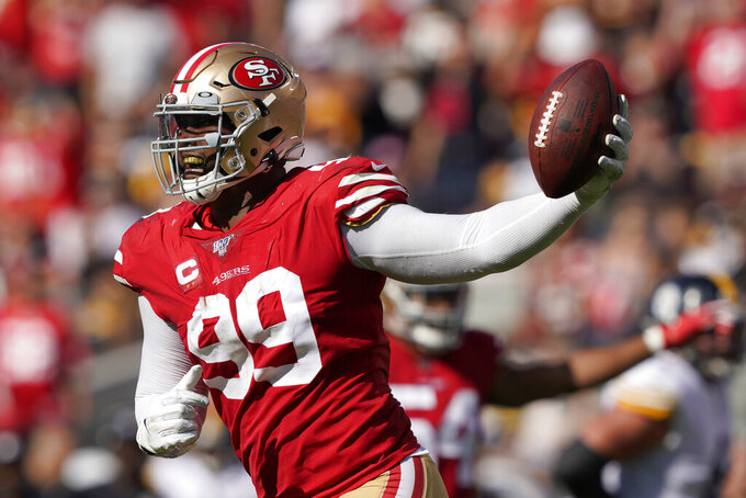 San Francisco 49ers defensive tackle DeForest Buckner (99) celebrates after recovering a fumble against the Pittsburgh Steelers during the second half of an NFL football game in Santa Clara, Calif., Sunday, Sept. 22, 2019. (AP Photo/Tony Avelar)