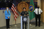 Police Chief Carmen Best, center, speaks at at a news conference, Monday, July 13, 2020, at City Hall in Seattle as Mayor Jenny Durkan, left, and Fire Chief Harold Scoggins , right, look on. Durkan and Best were critical of a plan backed by several city council members that seeks to cut the police department's budget by 50 percent. (AP Photo/Ted S. Warren)